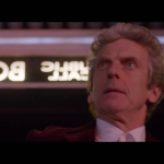 The Doctor in his red coat entering the TARDIS