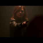 Clara holding a knife to...